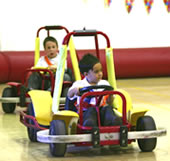 Two children driving around the track