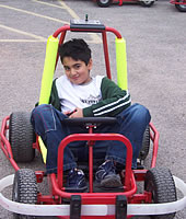 Boy in kart doing up lap strap